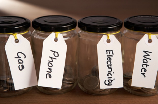 Coins in a jam jar - save on household bills as a student